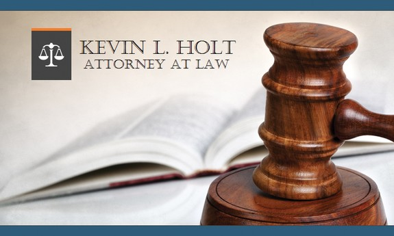 KEVIN L. HOLT